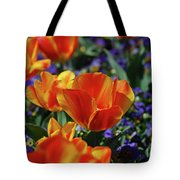 Bright Colored Garden With Striped Tulips In Bloom Tote Bag
