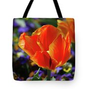 Brilliant Bright Orange And Red Flowering Tulips In A Garden Tote Bag