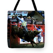 Bull Riding At The Grand National Rodeo Tote Bag