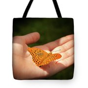 Butterfly On A Childs Hand Tote Bag