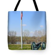 Cannon And Flagpole Overlooking River Tote Bag