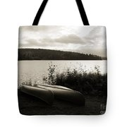 Canoe On A Shore Of A Lake At Dawn Tote Bag