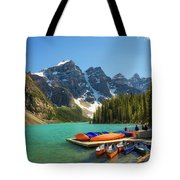 Canoes On A Jetty At  Moraine Lake In Banff National Park, Canada Tote Bag