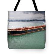 Cargo Ship Under Stormy Sky Tote Bag