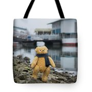 Cheerful Teddy Bear In Knitted Scarf Stand By The Riverside Beside The Port Tote Bag
