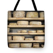 Cheese Wheels On Wooden Shelves In The Cheese Store Tote Bag
