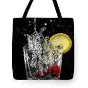 Cherries Splashing Into Sparkling Water Glass With Lemon Slice O Tote Bag