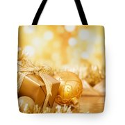 Christmas Scene With Gold Baubles And Gift On A Gold Background Tote Bag