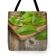 Close Up Fresh Basil Leafs On Rustic Serving Board  Tote Bag
