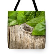 Close Up Fresh Basil Leafs On Rustic Wooden Boards Tote Bag