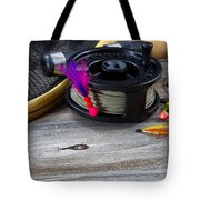 Close Up Of Fly Reel With Fly Jig Hanging From Spool  Tote Bag