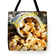 Closeup Of Walnuts Spilling From Small Bag Tote Bag
