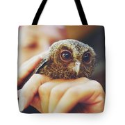 Closeup Portrait Of A Girl Holding And Tending A Small Baby Owl In Her Hands Tote Bag