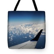 Clouds Under An Airplane Wing Tote Bag