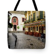 Cobblestone Argote De Molina Street With Cafe Ending At The Nort Tote Bag