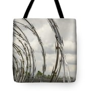 Coils Of Razor Wire On Fence Tote Bag