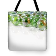 Composition With Green Marbles On White Background Tote Bag