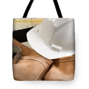 Construction Contractor Tools With Blue Print Drawings In Backgr Tote Bag