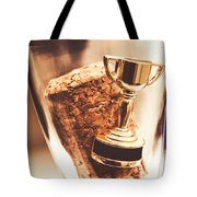 Cork And Trophy Floating In Champagne Flute Tote Bag