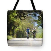 Couple Enjoying A Back Road Bike Ride Tote Bag