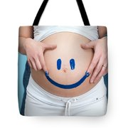 Couple Painting A Smiley On A Pregnant Woman's Belly Tote Bag