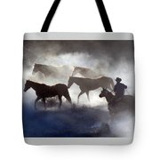 Cowboy Rounding Up Four Horses Tote Bag