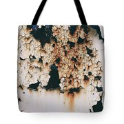 Cracking Light Paint On A Grunge Rusty Metal Door. Tote Bag