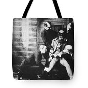 Criminal Being Held Down For Mug Shot Tote Bag