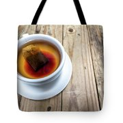 Cup Of Hot Tea On Wood Table Tote Bag