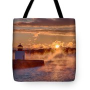 Dawn Peeking Over At Derby Lighthouse Tote Bag