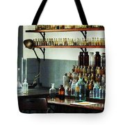 Desk With Bottles Of Chemicals Tote Bag