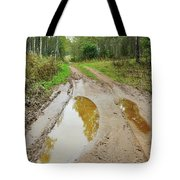 Dirty Autumn Road With Brown Pools After Rain Tote Bag
