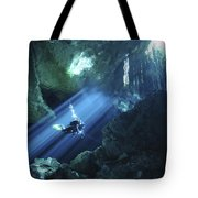 Diver Silhouetted In Sunrays Of Cenote Tote Bag