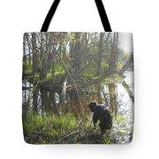 Dog Exploring Mississippi River Bank Tote Bag
