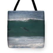 Dolphins Surfing The Waves Tote Bag