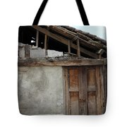 Door In The Wall Of A Building Tote Bag