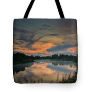 Dramatic Sunset Over The Misty River Tote Bag