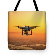 Drone Flying On Sunset Tote Bag