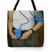 Elderly Man Wearing A Blood Pressure Tote Bag