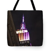 Empire State Building With A Light In A Window Tote Bag