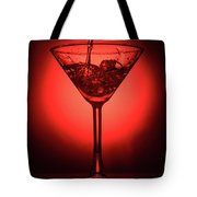 Empty Cocktail Glass On Red Background Tote Bag