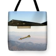 F 117 Nighthawk Engages Its Target And Drops A Gbu 28 Guided Bomb Tote Bag
