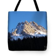 Fading Afternoon Sun Illuminates Mountain Peak  Tote Bag