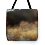 Fantastic Foggy River With Fresh Green Grass In The Sunlight. Tote Bag