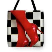Female Legs In Red Pantyhose And Shoes On High Heels On A Background Tote Bag