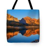 First Light Across Lake Sherburne Tote Bag by Greg Norrell