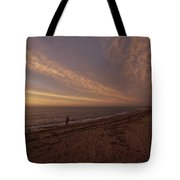 Fishermen Fishing In The Surf At Sunset Tote Bag