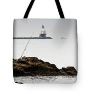 Fishing Rod On Rocks Tote Bag by Michael D Miller