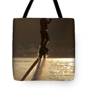 Flyboarder And Water Droplets Backlit At Sunset Tote Bag