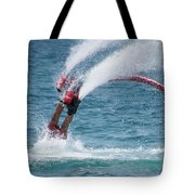 Flyboarder In Red Entering Water With Spray Tote Bag